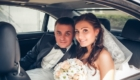 portrait of the happy bride and groom in the car