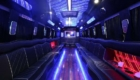a big party bus fill ed with comfortable seats and shiny bright